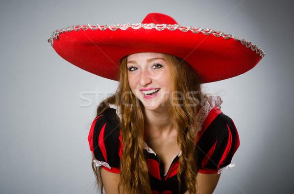 Nice donna indossare rosso sombrero Hat Foto d'archivio © Elnur