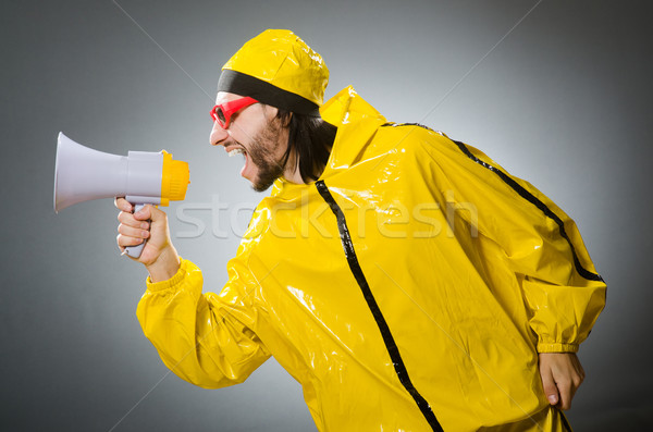 Man wearing yellow suit with loudspeaker Stock photo © Elnur