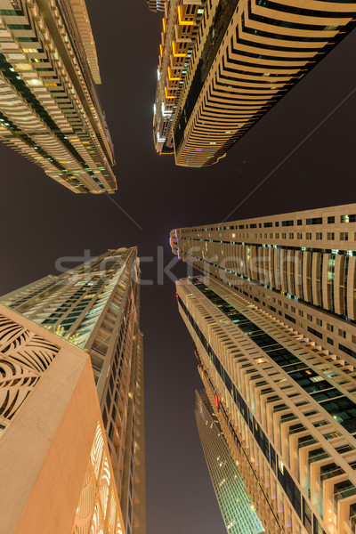 Stock photo: Skyscrapers of dubai during night hours