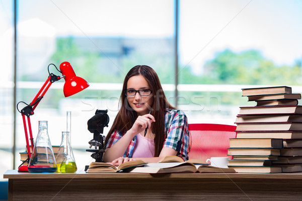 Female student preparing for chemistry exams Stock photo © Elnur
