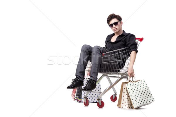 ストックフォト: 若い男 · ショッピングカート · 袋 · 孤立した · 白 · ショッピング