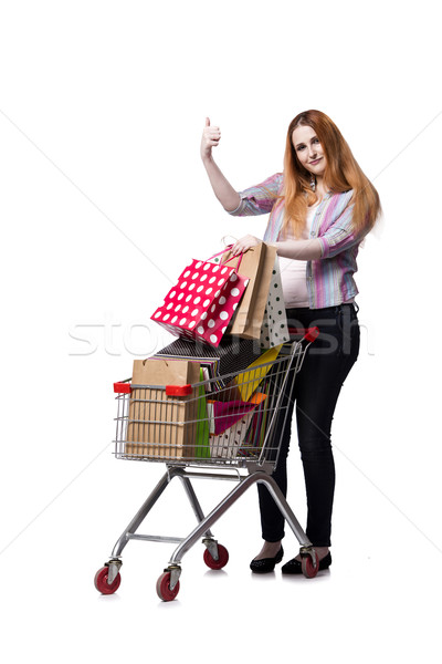 Woman with shopping cart and bags isolated on white Stock photo © Elnur