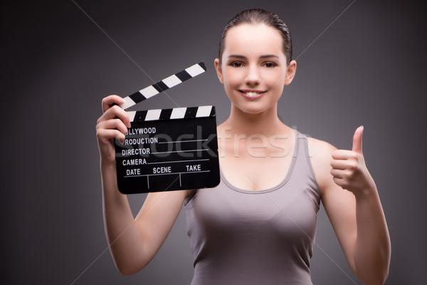 Kobieta film pokładzie kina strony uśmiech Zdjęcia stock © Elnur