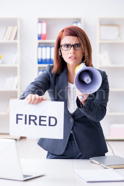 Businesswoman firing people in office Stock photo © Elnur