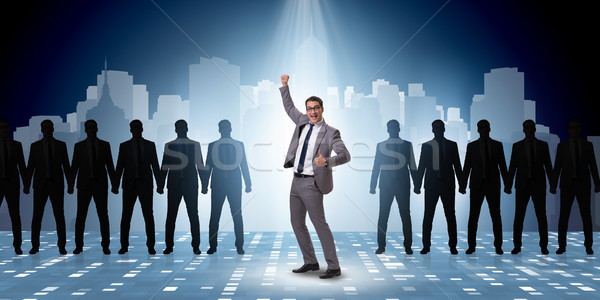 Businessman in the spotlight in business concept Stock photo © Elnur