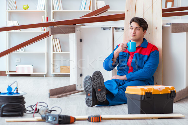 Young carpenter taking break from working with wooden planks Stock photo © Elnur