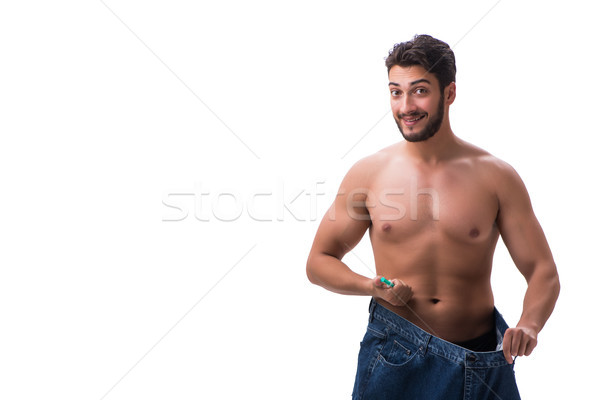 The man in dieting concept with oversized jeans Stock photo © Elnur