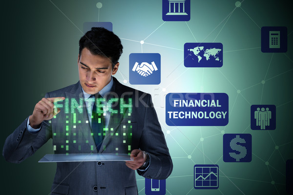 Businessman with tablet in financial technology fintech concept Stock photo © Elnur