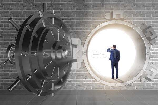 Businessman in front of banking vault door Stock photo © Elnur
