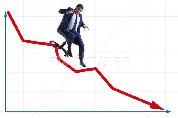 Businessman sliding down on chair in economic crisis concept Stock photo © Elnur
