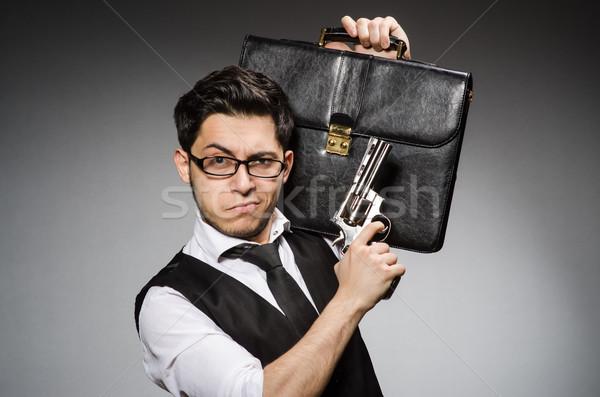 Adam tabanca evrak çantası el güvenlik işadamı Stok fotoğraf © Elnur