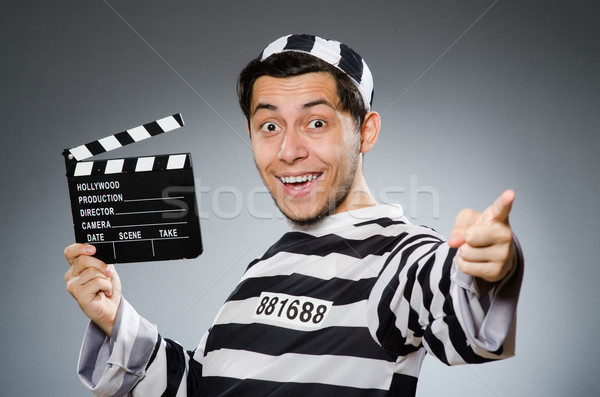 Inmate with movie clapper board Stock photo © Elnur