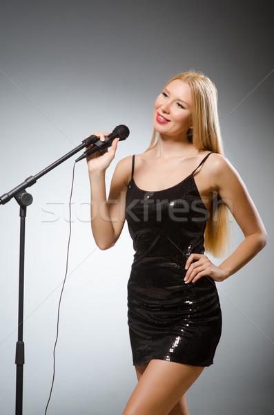 Stock photo: Woman singing in karaoke club