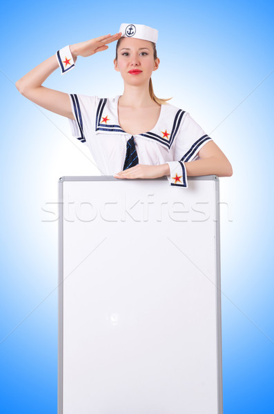 Stewardess with blank board on white Stock photo © Elnur