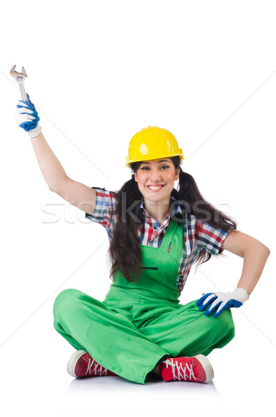 Female workman in green overalls holding key isolated on white Stock photo © Elnur