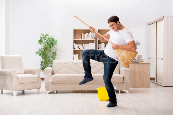 Man cleaning home with broom Stock photo © Elnur