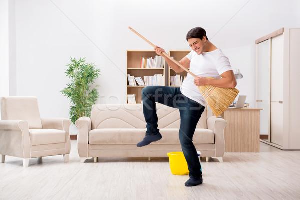 Homme nettoyage maison balai guitare industrie Photo stock © Elnur