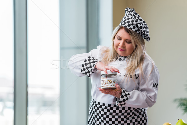 Stock photo: Woman cook working in the bright kitchen