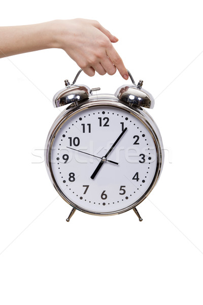 Hand holding alarm clock isolated on white Stock photo © Elnur