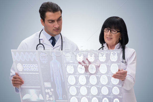 Woman and man doctor looking at MRI scan image Stock photo © Elnur