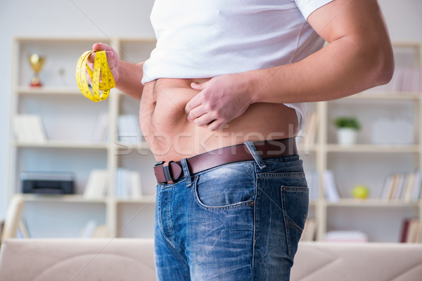 Man suffering from extra weight in diet concept Stock photo © Elnur