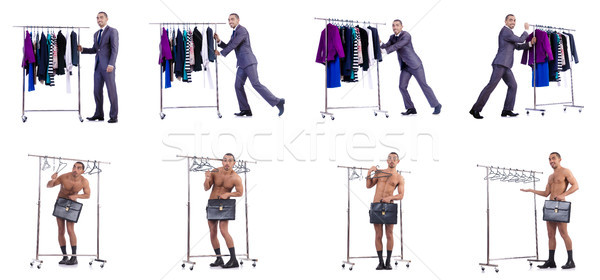 Businessman with rack of clothing Stock photo © Elnur