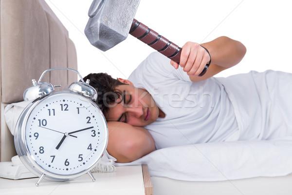 Hombre cama sufrimiento insomnio reloj sueno Foto stock © Elnur