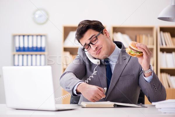 Сток-фото: голодный · смешные · бизнесмен · еды · сэндвич