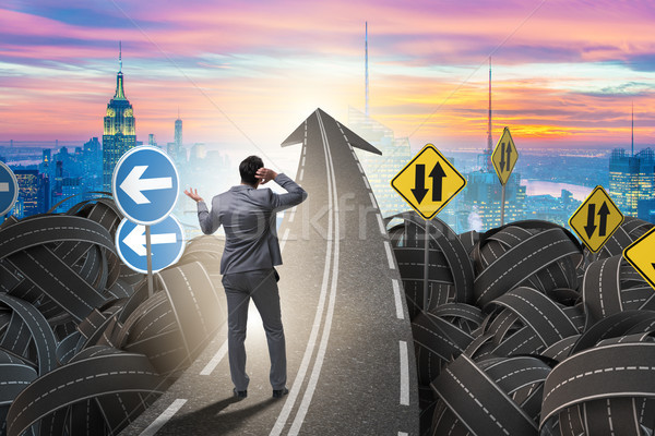 Businessman in uncertainty concept on road intersection crossroa Stock photo © Elnur