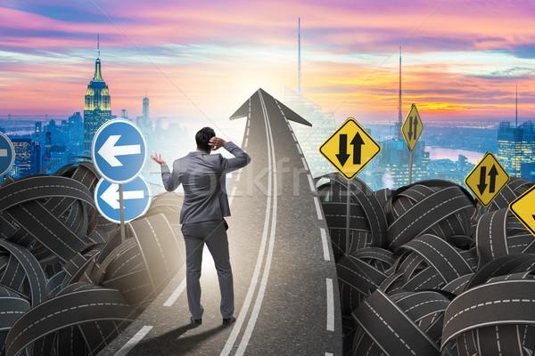 üzletember bizonytalanság út kereszteződés útkereszteződés állás Stock fotó © Elnur