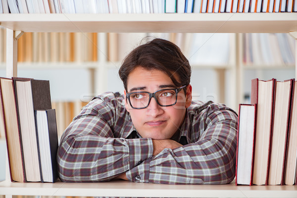 The young student looking for books in college library Stock photo © Elnur