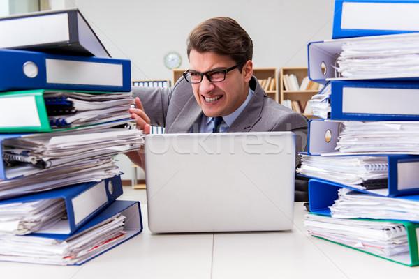 Busy businessman under stress due to excessive work Stock photo © Elnur