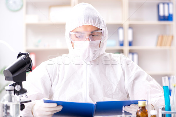 Young chemist student working in lab on chemicals Stock photo © Elnur