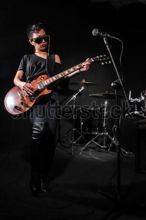 Monster playing violin in dark room Stock photo © Elnur