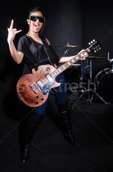 Donna chitarrista concerto musica party sfondo Foto d'archivio © Elnur