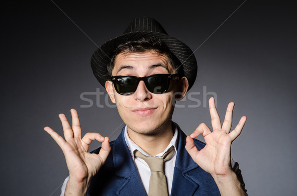 Genç mavi yelek şapka gri adam Stok fotoğraf © Elnur