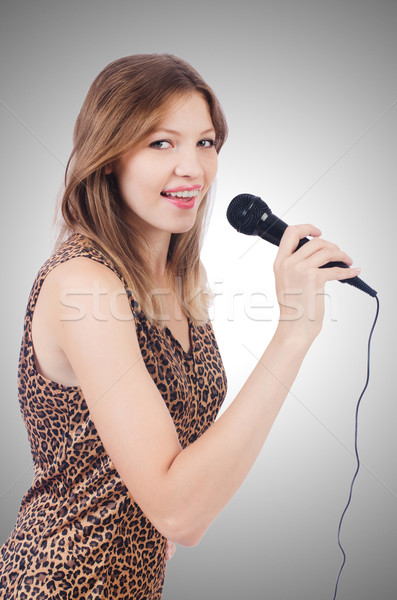 Woman singer with microphone on white Stock photo © Elnur