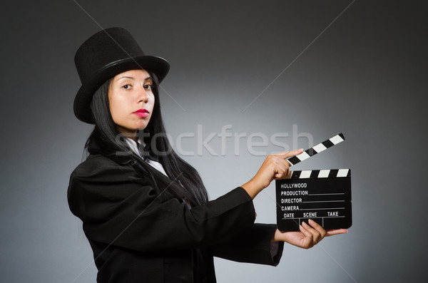 Woman with vintage hat and movie board Stock photo © Elnur
