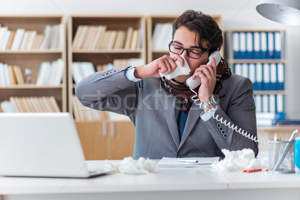 The sick businessman suffering from illness in the office Stock photo © Elnur
