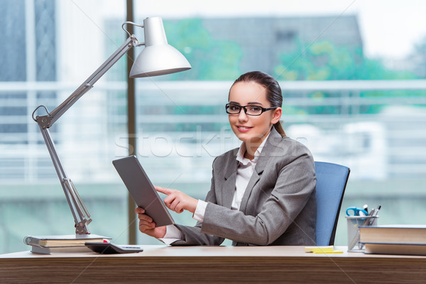 Businesswoman working with tablet computer in business concept Stock photo © Elnur