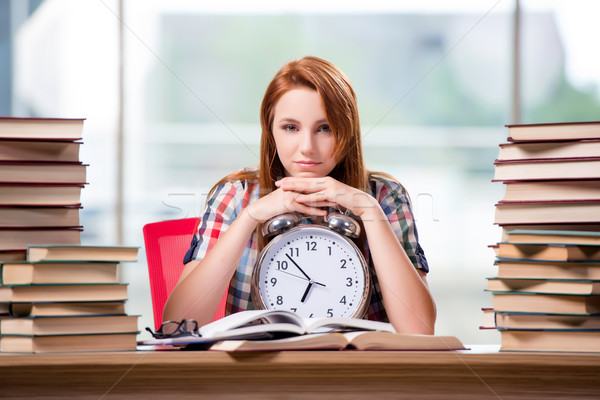 The female student with clock preparing for exams Stock photo © Elnur