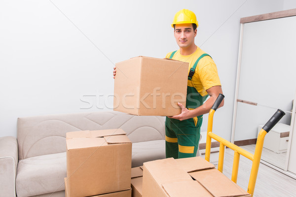 Transportation worker delivering boxes to house Stock photo © Elnur
