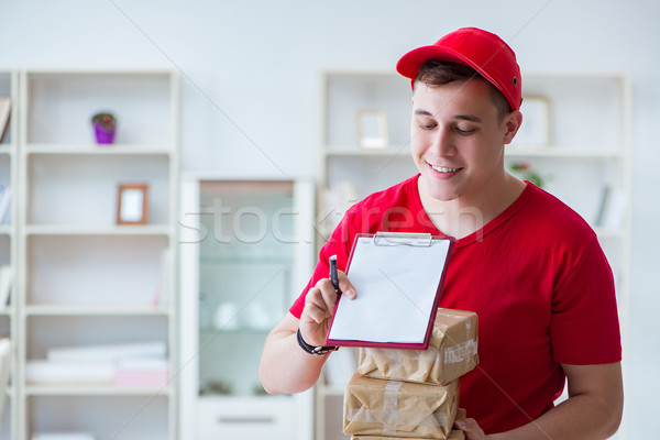 The post man delivering a parcel package Stock photo © Elnur