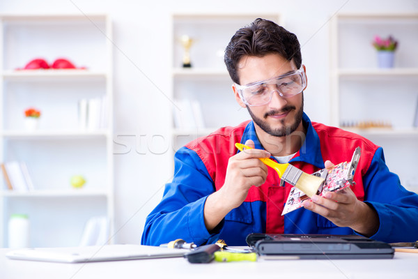Repairman working in technical support fixing computer laptop tr Stock photo © Elnur