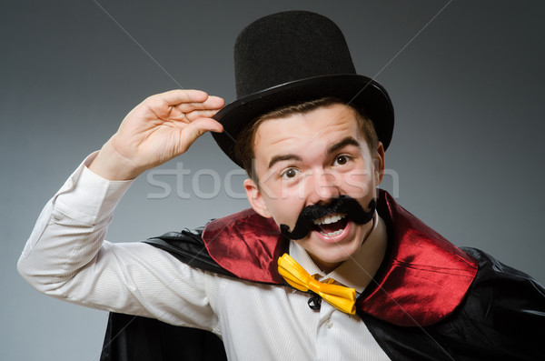 Funny magician with wand and hat Stock photo © Elnur
