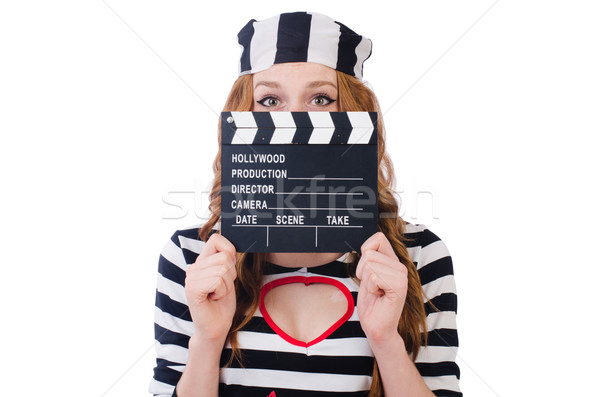 Young woman-prisoner with movie board isolated on white Stock photo © Elnur