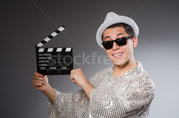 Young camera assistant with clapperboard Stock photo © Elnur