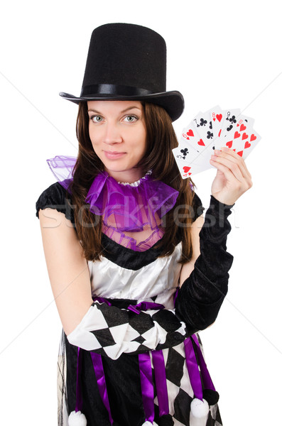 Pretty girl in jester costume with cards isolated on white Stock photo © Elnur