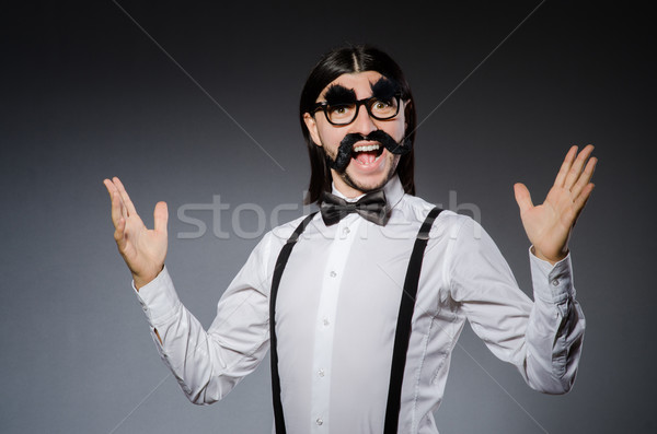 Man with moustache and sunglasses against gray Stock photo © Elnur
