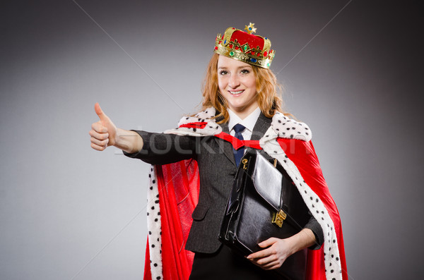 Pretty businessman with crown and case isolated on gray Stock photo © Elnur